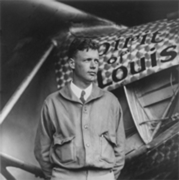 Charles Lindbergh standing in front of his plane, The Spirit of St. Louis